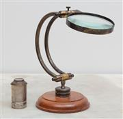 Sale 8644A - Lot 21 - A brass & glass table magnifying glass together with an eye piece.