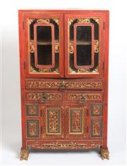 Sale 8517A - Lot 93 - A Chinese red and gold painted fruitwood cabinet with two pierced glass panelled doors, three drawers and two smaller doors, H 85 x...