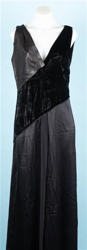 Sale 9083F - Lot 9 - A BALLY BLACK FLOOR LENGTH DRESS; front bodice comprises of velvet diagonally from left shoulder to waist with leather over the righ...