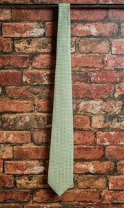 Sale 8420A - Lot 79 - A Tonno mens cream silk tie, condition: new