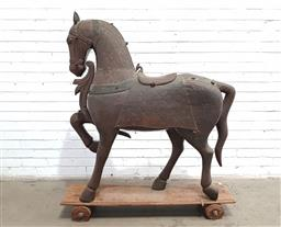Sale 9126 - Lot 1001 - Indian Carved Timber Brass Clad Toy Horse, in prancing pose, raised on a timber base with wheels (h:142 x l:112cm)