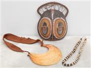 Sale 8644A - Lot 38 - A PNG mask painted in natural ochres together with a mother of pearl and cowrie shell necklace, and a shell beaded necklace.