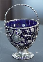 Sale 8319 - Lot 211 - .925 silver mounted sugar bowl with original blue glass liner, floral and leaf frame