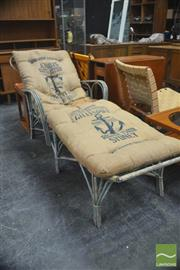 Sale 8326 - Lot 1015 - Cane Sun Lounge with Roller Flour Hessian Covering