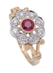 Sale 9012 - Lot 369 - AN EDWARDIAN STYLE RUBY AND DIAMOND CLUSTER RING; set in 9ct gold with central round cut treated ruby to surround of 8 round brillia...