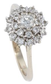 Sale 8954 - Lot 381 - AN 18CT GOLD DIAMOND CLUSTER RING; centring a round brilliant cut diamond of approx. 0.10ct to double surround of a further 20 brill...