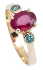Sale 9083F - Lot 28 - A 9CT GOLD RUBY AND DIAMOND RING; centring a 7.7 x 5.8mm oval cut glass filled ruby between 2 round brilliant cut treated blue diamo...