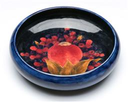 Sale 9093 - Lot 53 - William Moorcroft Pomegranate Serving Bowl (H: 6cm Dia: 25cm) (chip to base)