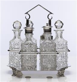 Sale 9245R - Lot 4 - An excellent quality antique silverplate Arts and Crafts design cruet stand by John Sherwood & Sons , Birmingham C: 1890, fitted wit...
