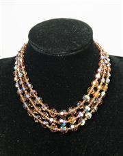 Sale 8420A - Lot 2 - A 1930's vintage amber graduating crystal three strand necklace with borealis crystal clasp, condition: excellent