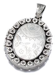 Sale 9054 - Lot 372 - A VICTORIAN STYLE LARGE SILVER LOCKET PENDANT; oval locket engraved front and back opening to twin compartment, size 60 x 40mm, wt....
