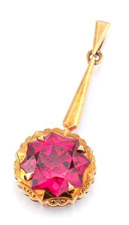 Sale 9083 - Lot 370 - A VINTAGE 14CT GOLD STONE SET PENDANT; centring an 8 point star cut synthetic ruby on a long tapered surmount, length 35mm, wt. 3.4g.