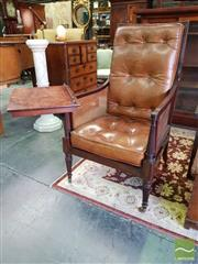 Sale 8539 - Lot 1045 - Fine Regency Mahogany Library Armchair, with caned back, sides & seat, loose buttoned brown leather cushions, adjustable reading sta...