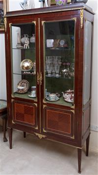 Sale 8963H - Lot 5 - A Louis XVI style mahogany vitrine with gilt brass mounts and two glass panelled doors on tapering legs, Height 166cm x Width 96cm x...