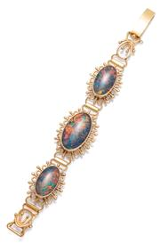 Sale 9083 - Lot 361 - A VINTAGE 18CT GOLD OPAL BRACELET; featuring 3 graduated plaque links each set with a black opal triplet to decorative wire work sur...