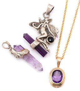 Sale 9149 - Lot 302 - A GOLD AND TWO SILVER AMETHYST PENDANTS; a 9ct gold pendant set with an oval cut amethyst, length 22mm, wt. 1.78g, on a gilt metal c...