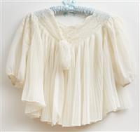 Sale 9080H - Lot 80 - A vintage bedjacket in ivory with tie up front size S