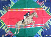 Sale 8837 - Lot 367 - A GUCCI EQUESTRIAN SILK SCARF; featuring show jumping on red, green and navy ground, 88 x 88cm.