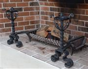 Sale 8782A - Lot 34 - A large pair of wrought iron gueridon/ firedogs each height 56cm depth together with a cast iron fire basket or pit width 90cm