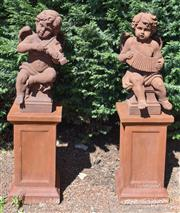 Sale 8950G - Lot 78 - A pair of composite statues of cherub musicians on plinths 1.43m height top of base measurement 38cm by 38cm