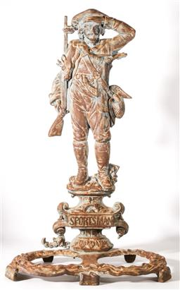 Sale 9093 - Lot 54 - A Victorian Cast Iron Gun Stand, Posed with Hunter in Salute, Monogrammed SPORT MAN to Base H82cm,