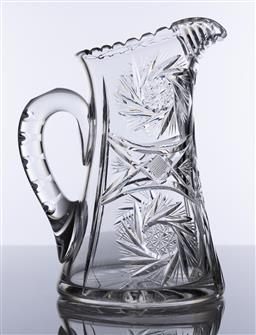 Sale 9245R - Lot 11 - A large and heavy fancy hand cut lead crystal jug, C:1940s, with elaborate cut work of Catherine wheels. Ht: 24cm