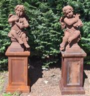 Sale 8950G - Lot 79 - A pair of composite statues of cherub musicians on plinths1.43m height top of base measurement  38cm by 38cm