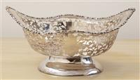 Sale 8963H - Lot 6 - An Early C20th sterling silver pierced footed bonbon bowl with foliate scrolls, marked Chester, Maker GN/RH, Length 25cm weight 405g