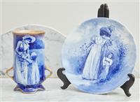 Sale 9090H - Lot 46 - A Royal Doulton blue and white twin handled vase and plate depicting mother and child. Height of vase 17cm