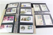 Sale 8944 - Lot 95 - 4 Binders of First Day Covers incl. some with Five Dollar Coin, Dollar Coins, Fifty & Twenty cent coins, Plus Medallions