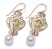 Sale 9012 - Lot 359 - A PAIR OF NOUVEAU STYLE PERIDOT AND PEARL EARRINGS; 9ct gold scrolling wirework drops set with oval cut peridots suspending freshwat...