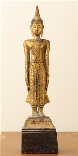 Sale 9164H - Lot 19 - A Thai carved and gilt standing buddha, arms down, inscription to back of base, total Height 32cm