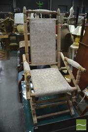 Sale 8345 - Lot 1049 - White Washed Dexter Style Rocking Chair, with white floral fabric