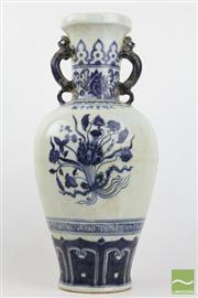 Sale 8490 - Lot 71 - Chinese blue and white double handled vase, Xuande mark, body decorated with three lotus floral roundels