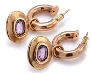 Sale 9095 - Lot 345 - A PAIR OF 9CT GOLD AMETHYST EARRINGS; each a hollow 16.7mm wide full round hoop with a detachable 15.33 x 18.73mm plaque rub set wit...