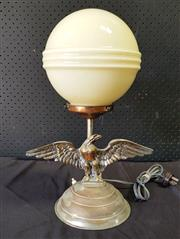 Sale 9056 - Lot 1007 - Eagle Form Table Lamp with Art Deco Ball Shade (H:46cm)