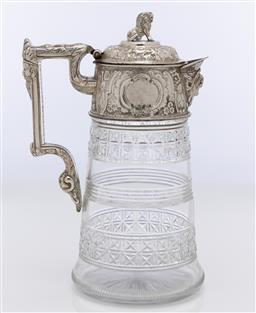 Sale 9245R - Lot 17 - Exceptional antique hand cut lead crystal and elaborate silverplate wine ewer C: 1890s, the lion finial lid above a deep rim with a...