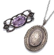 Sale 9054 - Lot 328 - VICTORIAN STYLE STERLING SILVER LOCKET PENDANT NECKLACE AND AMETHYST BROOCH; engraved oval locket opening to a double compartment, s...