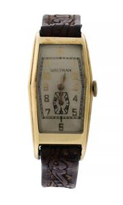 Sale 8618A - Lot 3 - An early C20th Waltham curved tank wristwatch;
