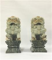Sale 8706A - Lot 64 - A pair of jade stone Chinese foo dog statues, carved from, general wear, H 29 x W 15cm