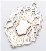 Sale 9072 - Lot 113 - A small silver pendant shield. weight 9.7g