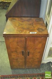 Sale 8371 - Lot 1093 - Singer Sewing Machine in Walnut Cabinet