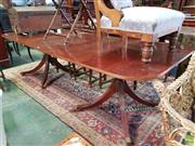 Sale 8598 - Lot 1079 - Georgian Style Mahogany Extension Dining Table, including single leaf, the D ends with crossbanding, on turned pedestals with outs...
