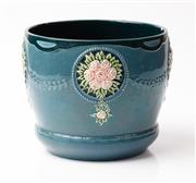 Sale 9048A - Lot 11 - A German pottery jardiniere with applied rose decoration on Persian blue background, impressed to base 7837-3 Eichwald (chip to inte...