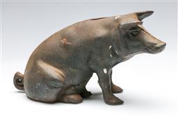 Sale 9156 - Lot 37 - A cast iron pig themed moneybox (L:26cm)