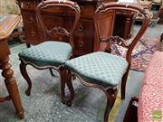 Sale 8485 - Lot 1029 - Set of Four Carved Rosewood Chairs, with balloon backs, scale pattern upholstery & cabriole legs