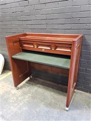 Sale 9006 - Lot 1073 - Timber Framed Desk with a Leather Top on Castors (H:115 x W:121 x D:59cm)
