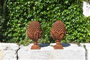 Sale 9087H - Lot 100 - A pair of cast iron finials. 50cm height