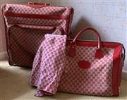Sale 8510A - Lot 97 - A vintage Gucci fold over suitcase in red canvas monogram together with a matching hold all bag and fabric swatch