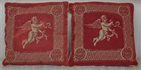 Sale 9080H - Lot 44 - A pair of cushions printed with cherubs in flight on a claret ground